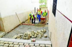Trabajadores en las obras de reparación de la Cuesta Robas.